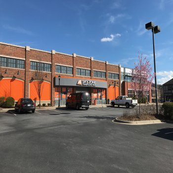 Front entrance and parking lot of Sky Zone in Gerber Village located in North Carolina.